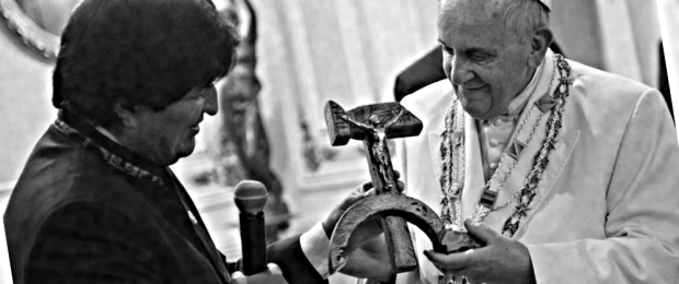 "Pope Francis is presented with a gift of crucifix carved into a wooden hammer and sickle, the Communist symbol uniting labor and peasants, by Bolivian President Evo Morales in La Paz, Bolivia, Wednesday, July 8, 2015.  Apart from the carved hammer and sickle, Morales gave Francis another politically loaded gift, a copy of ""The Book of the Sea,"" which is about the loss of Bolivia's access to the sea during the War of the Pacific with Chile in 1979-83.  Morales said things ahve changed with this pope and the Bolivian people are greeting Francis as somone who is ""helping in the liberation of our people."" (L'Osservatore Romano/Pool Photo via AP)"