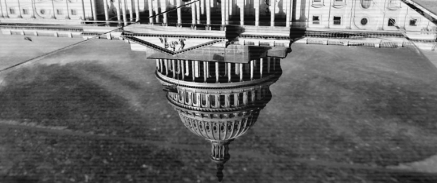 A reflection of the U.S. Capitol, 17 February 2012. (Detail of photo by Kevin LaMarque/Reuters)