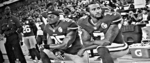 Colin Kaepernick (r.) and Eric Reed kneel during the national anthem before a 2016 NFL game. (Photo: Associated Press)